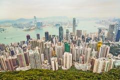 Panorama- horisont av Hong Kong City som ses från maximumet Fotografering för Bildbyråer