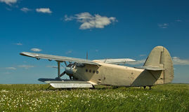Panorama horizontal; grey plane on the field in parking, airshow. Blu sky background stock photo