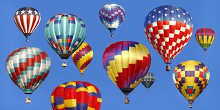 Panorama of Hot Air Balloons Ascending in a Bright Blue Sky. Panorama of Colorful Hot Air Balloons Ascending in a Bright Blue Sky royalty free stock images