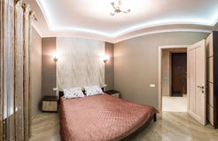 Panorama hotel room. Small bedroom with double bed Royalty Free Stock Photo