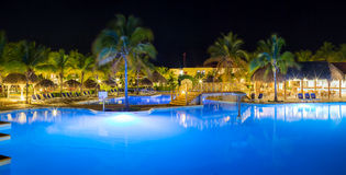 Panorama of hotel and swimming pool at night Stock Images