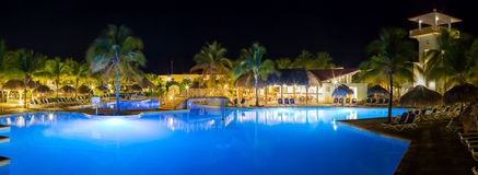 Panorama of hotel and swimming pool at night Stock Photography