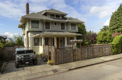 Panorama of a house and vehicle in Seattle WA. Panorama of a sport utility vehicle and a house in Seattle WA royalty free stock photography