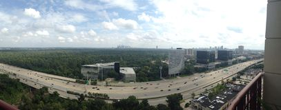 Panorama of Houston skyline. Panoramic view of Houston, Texas, overlooking Loop 610 and Memorial Park with downtown in the distance Stock Photography