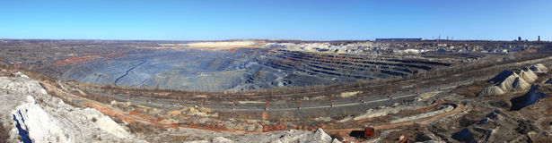 Panorama huge quarry iron ore mining Gubkin Russian Spring Stock Images