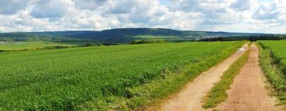 Panorama Hunsrueck von Thalfang bis Hermeskeil. Mit Feldern und einem Weg stock images