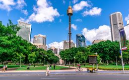 Panorama of Hyde Park with people and Sydney CBD skyline and Sydney tower eye in background in NSW Australia. 23th December 2018, Sydney NSW Australia: Panorama royalty free stock photos
