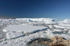 Panorama on icebergs and ice on the water in front of him, terrain and scenery Antarctic. Day, sunset stock image