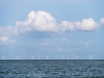 Lake IJsselmeer horizon with wind turbines of windfarm near Urk, Netherlands stock photos