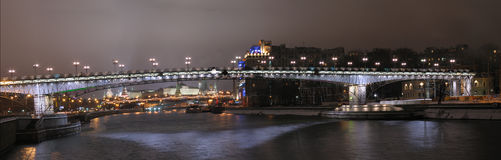 The panorama of an illuminated bridge. In Moscow Stock Photo