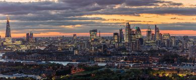 Panorama of the illuminated skyline of London after sunset royalty free stock photos