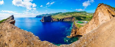 Panorama Image of soccer field and landscape next to a cliff and the atlantic sea below royalty free stock images