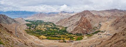 Panorama of Indus valley in Himalayas. Ladakh, India. Panorama of green Indus valley from ascend to Kardung La pass - allegedly the highest motorable pass in the Royalty Free Stock Image
