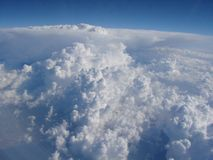Sky panorama of the aircraft illuminator at an altitude of 9000 m above sea level. Panorama of an infinite snow-white cloudy field on the background of sky blue royalty free stock image