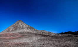 Panorama inside crater of Pico volcano and Piquinho pinnacle, Azores, Portugal. Panorama inside crater of Pico volcano and Piquinho pinnacle at Azores, Portugal royalty free stock photo