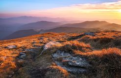 Panorama with interesting sunrise enlightens surroundings. Landscape with beautiful mountains and stones. Fantastic autumn scenery. Touristic resort Carpathian royalty free stock image