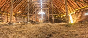 Panorama interior of old farm barn with straw Royalty Free Stock Image
