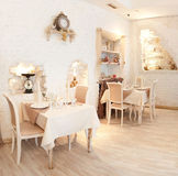 Panorama. Interior in restaurant. Beige. Tables Royalty Free Stock Images