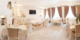 Panorama. Interior in restaurant. Beige, tables Royalty Free Stock Photography