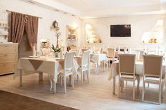 Panorama. Interior in restaurant. Beige. Tables Royalty Free Stock Photography