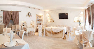 Panorama. Interior in restaurant. Beige, tables, curtain Royalty Free Stock Photo