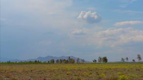 Panorama of the Iranian plain. On the horizon mountains are seen, the sky is tightened by cumulonimbus clouds stock footage