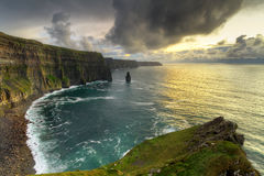Panorama of irish cliffs at sunset. Cliffs of Moher at sunset, Co. Clare, Ireland Stock Image