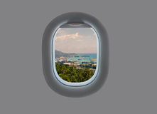 Panorama of the island of Mahe in the plane window. Tropical Seychelles in airplane window Stock Photography
