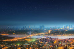 Panorama of Istanbul and Bosphorus bridge at night Stock Photography