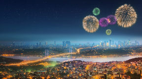 Panorama of Istanbul at night with fireworks stock photography
