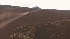 Panorama. Jeep rides on the road. Red Earth, Wild Russia. stock video footage