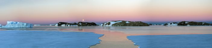 Panorama and just air .On ice floes, terrain and scenery Antarctic .Sunrise, day, sunset. Shooting with quadrocopter stock photography