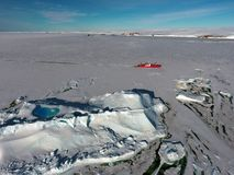 Panorama and just air. View of the ocean, icebergs and polar station, terrain and scenery Antarctic. Sunrise, Day, sunset. Shooting with quadrocopter royalty free stock images