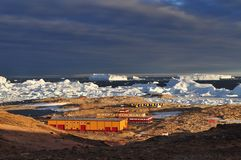 Panorama and just air. View of the ocean, icebergs and polar station, terrain and scenery Antarctic. Sunrise, Day, sunset. Shooting with quadrocopter royalty free stock image