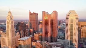 Panorama 4k aerial view on tall modern skyscrapers in busy financial downtown district in Columbus city Ohio in sunset stock video footage