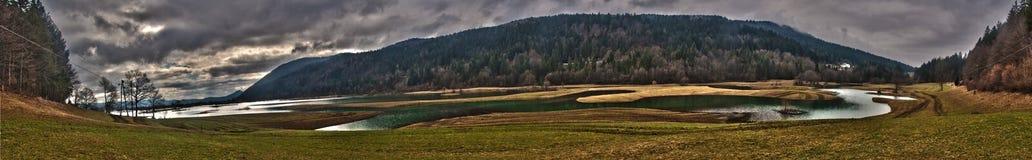 Panorama of Karst fields and lake Stock Photos