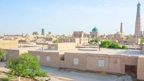 Panorama of Khiva. KHIVA, UZBEKISTAN – MAY 3, 2015: The medieval rampart is the best viewpoint, that overlooks old town with its high minarets and brick domes stock video footage