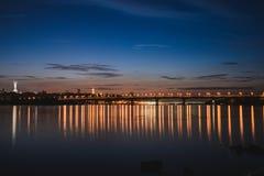 Panorama of Kiev city at night. Kyiv Left bank skyline with Paton bridge over Dnieper river. Stock Photo