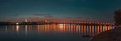 Panorama of Kiev city at night. Kyiv Left bank skyline with Paton bridge over Dnieper river. Stock Photography