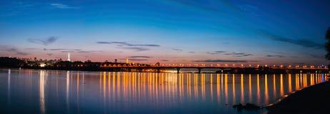 Panorama of Kiev city at night. Kyiv Left bank skyline with Paton bridge over Dnieper river. Royalty Free Stock Image