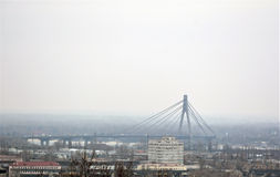 Panorama of Kiev in fog. KIEV - UKRAINE - FEBRUARY 2017: View from the hill on the Moskovsky bridge over Dnieper river and buildings. Panorama of Kiev in fog Royalty Free Stock Image