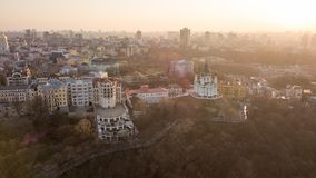 Panorama of Kiev and St. Andrew`s Church on sunset, Ukraine. Aerial panorama view Kiev city in evening sunset with St Andrew`s Church, Ukraine. Drone photo stock photography