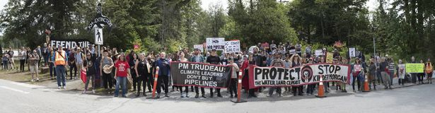 Panorama of Kinder Morgan protesters against the government`s purchase of Kinder Morgan pipeline project. Seen in this panorama shot on June 2nd, 2018 protesters royalty free stock image