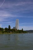 Panorama of Kleinbasel with Rhine, ships and Headquarter Building of Roche. In Kleinbasel (part of the city basel) stays the office building at the headquarter Stock Photography