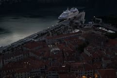 Panorama of Kotor Old Town with Cruise Ship Seen from Lookout. At Dusk, Montenegro Royalty Free Stock Photo