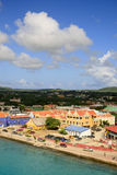Panorama of Kralendikh, Bonaire. A panorama or general view of Kralendikh, capital of the island of Bonaire. The Dutch style buildings with red roofs are along Stock Photo