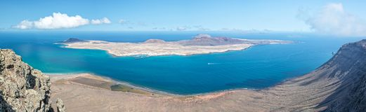 Panorama of La Graciosa island, aerial view from Mirador del Rio in Lanzarote, Canary islands Spain. Panorama of La Graciosa island, aerial view from Mirador del Stock Photography