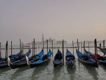 Panorama with lagoon and gondole in Venice. Typical landscape of Venice with soft colors of sky, gondole and water lagoon stock photography
