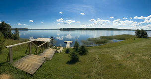 Panorama of the lake. With steps to the water Royalty Free Stock Photos