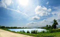 Panorama of the lake. Big size panorama of the lake with road, grass, tree and beautiful sky Royalty Free Stock Image